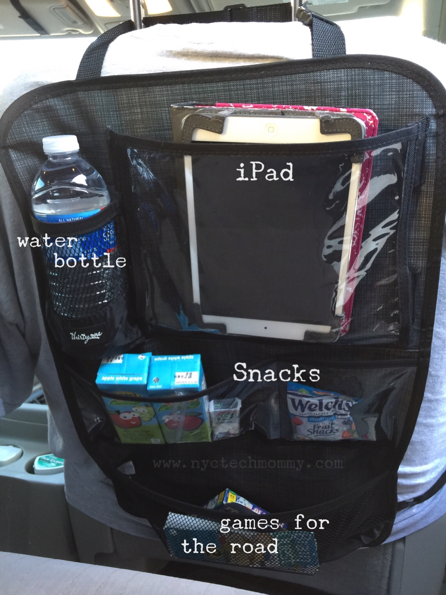 The Hang Up Activity Organizer from Thirty-One - Hangs neatly behind your car seat and helps keep all of your kid's stuff organized and within arms length. No more nagging and asking for snacks during long road trips!