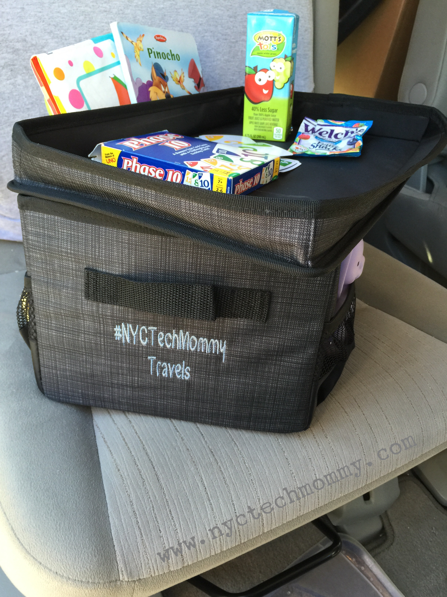 The Flip-Top Organizing Bin from Thirty-One is the perfect place to store all of your kids stuff, toys, snacks, a change of clothes, and more. The top doubles as a table when on the go. Check out my other tips for getting your car and kids organized. Click now!