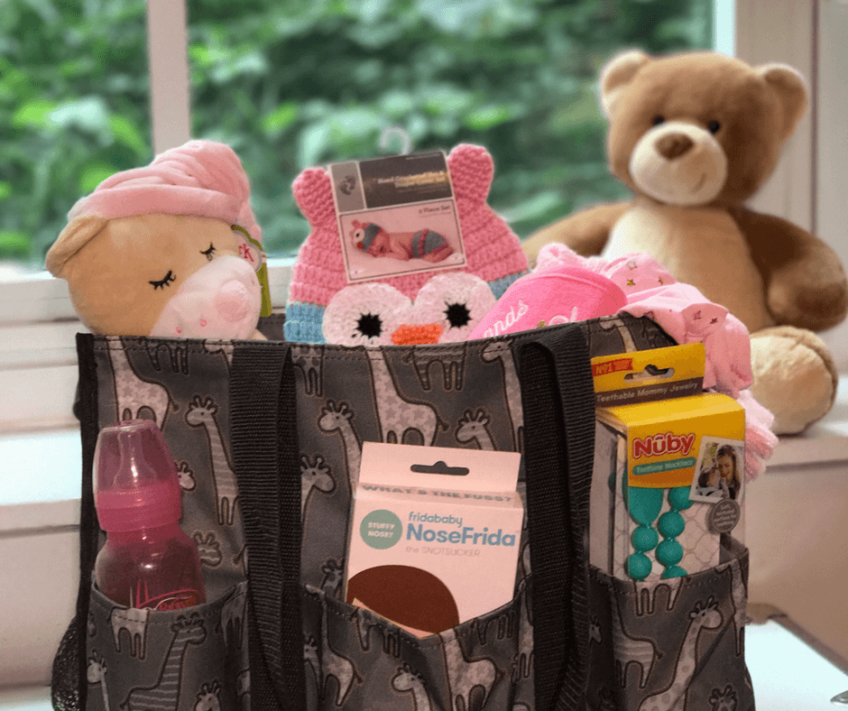 Baby Shower Gift Idea -- Stuff all your favorite baby essentials into an adorable Thirty-One bag for baby