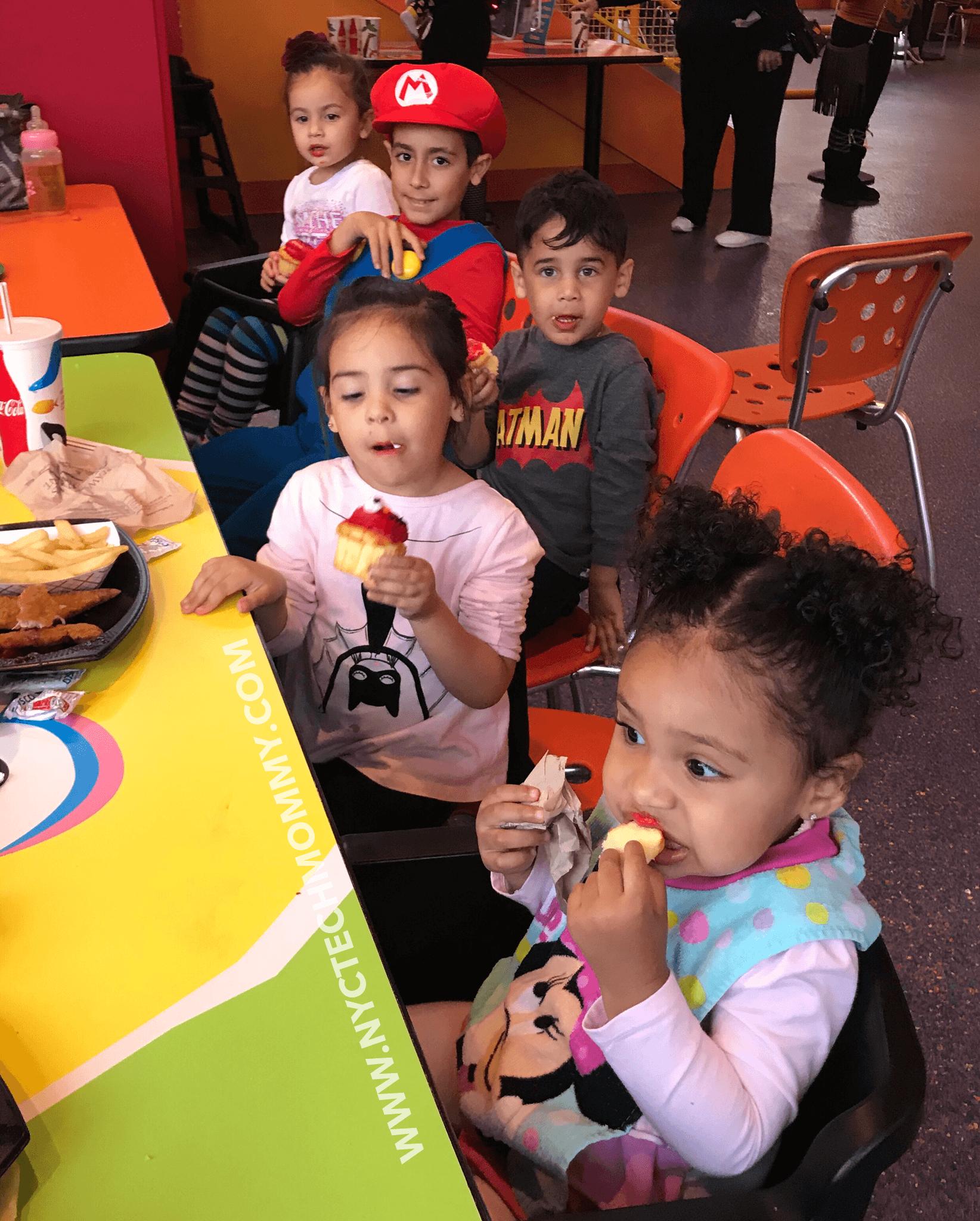 Eating Elmo cupcakes - Sesame Place